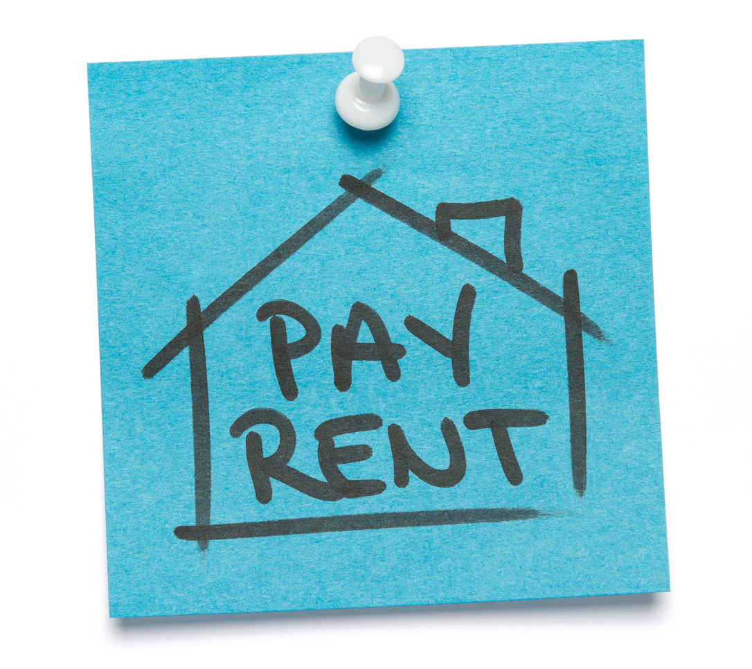 "Blue sticky note written on ""Pay Rent"" with push pin. Isolated o white background with clipping path."